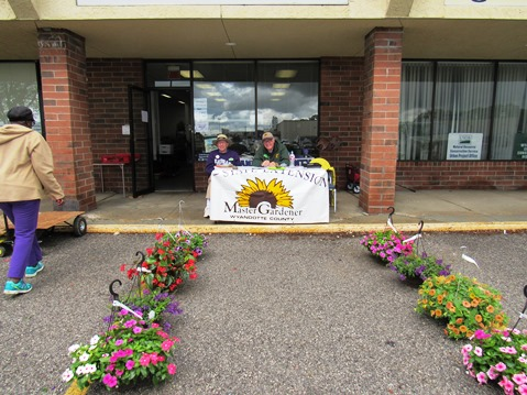 David Young, left, and Don Crim staffed a table for the Master Gardeners Plant Sale Saturday, April 30, at the Extension Office, 1200 N. 79th St., (west of Kmart), Kansas City, Kan. The sale runs through 2 p.m. Saturday. They had tomato and pepper plants, herbs, hanging baskets, flowers and more available. Proceeds benefit the Master Gardeners' activities in Wyandotte County. (Staff photo by Mary Rupert)