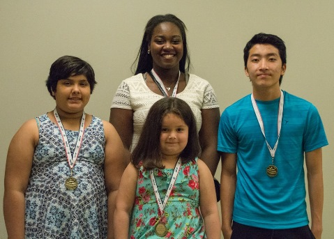 Honored as students of the month for April were, middle, back, Grace Wright, Schlagle High School; front row, from left, Carolina Lozano-Perez, Quindaro Elementary; Jamielynn Renova Parra, Morse Elementary Childhood Center; and Por Choua Lor, Central Middle. (Photo from Kansas City, Kan., Public Schools)