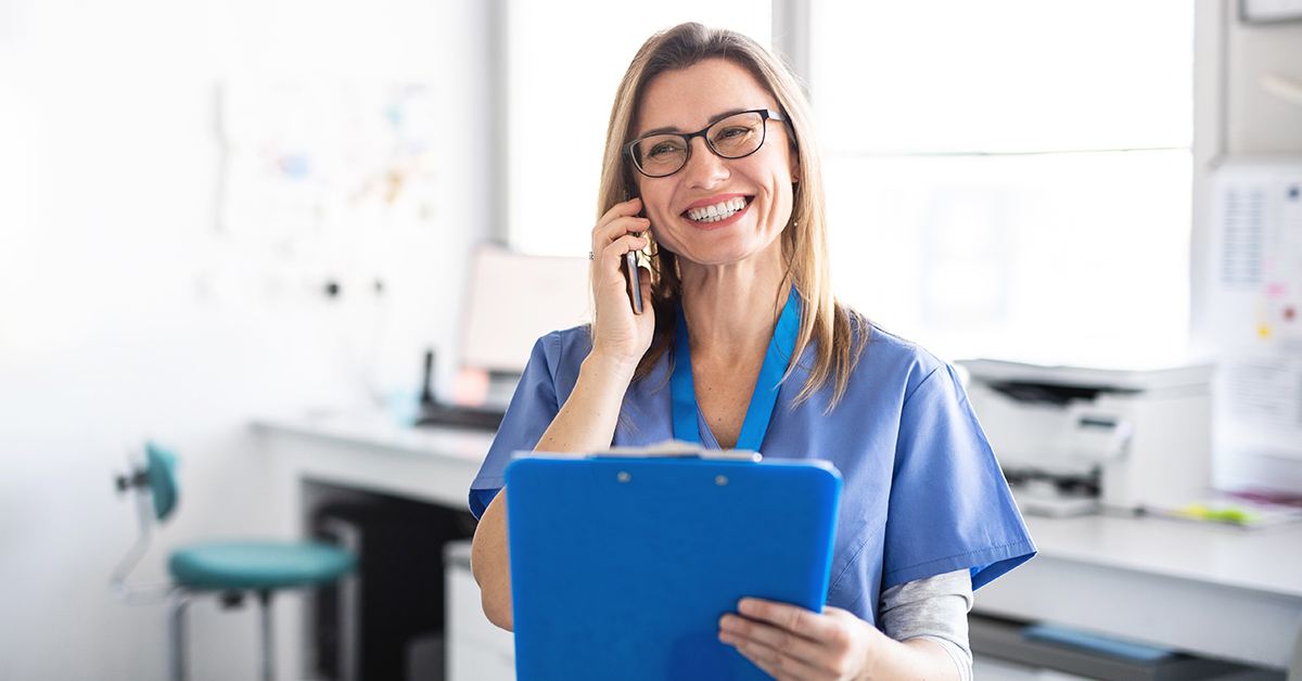 A nurse prescreening a patient over the phone.
