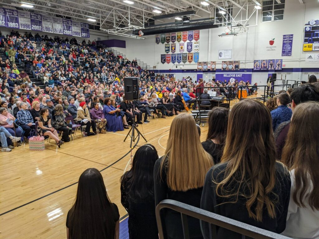 school gym full of choral festival attendees