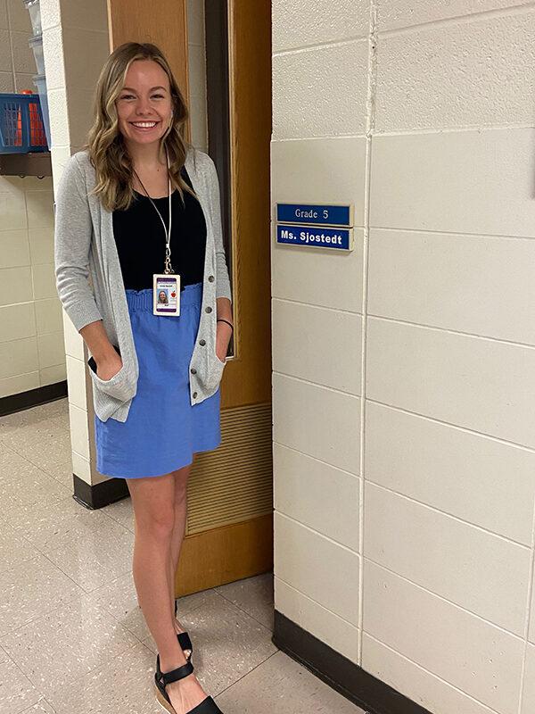Natalie Sjostedt standing in a hallway.