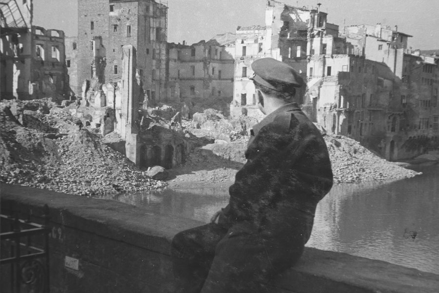 Man looking at the destruction from tiger Ponte Vecchio in 1945, photo credit: afs.org.