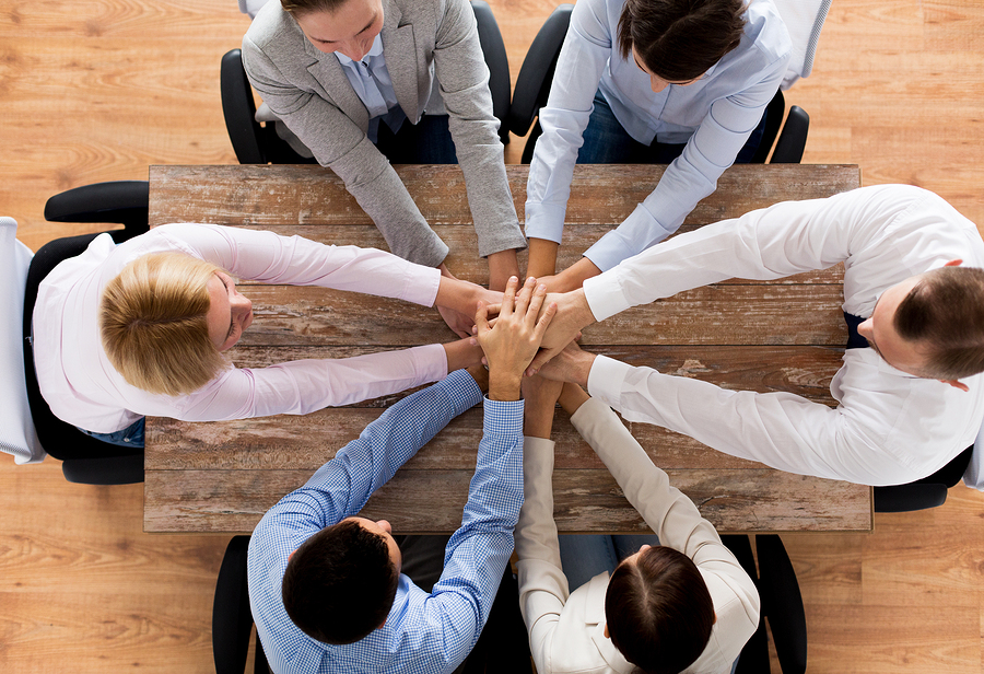 business, people, cooperation and team work concept - close up o