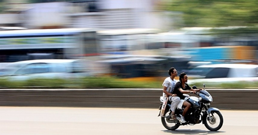 Ride a motorcycle fast, without a helmet