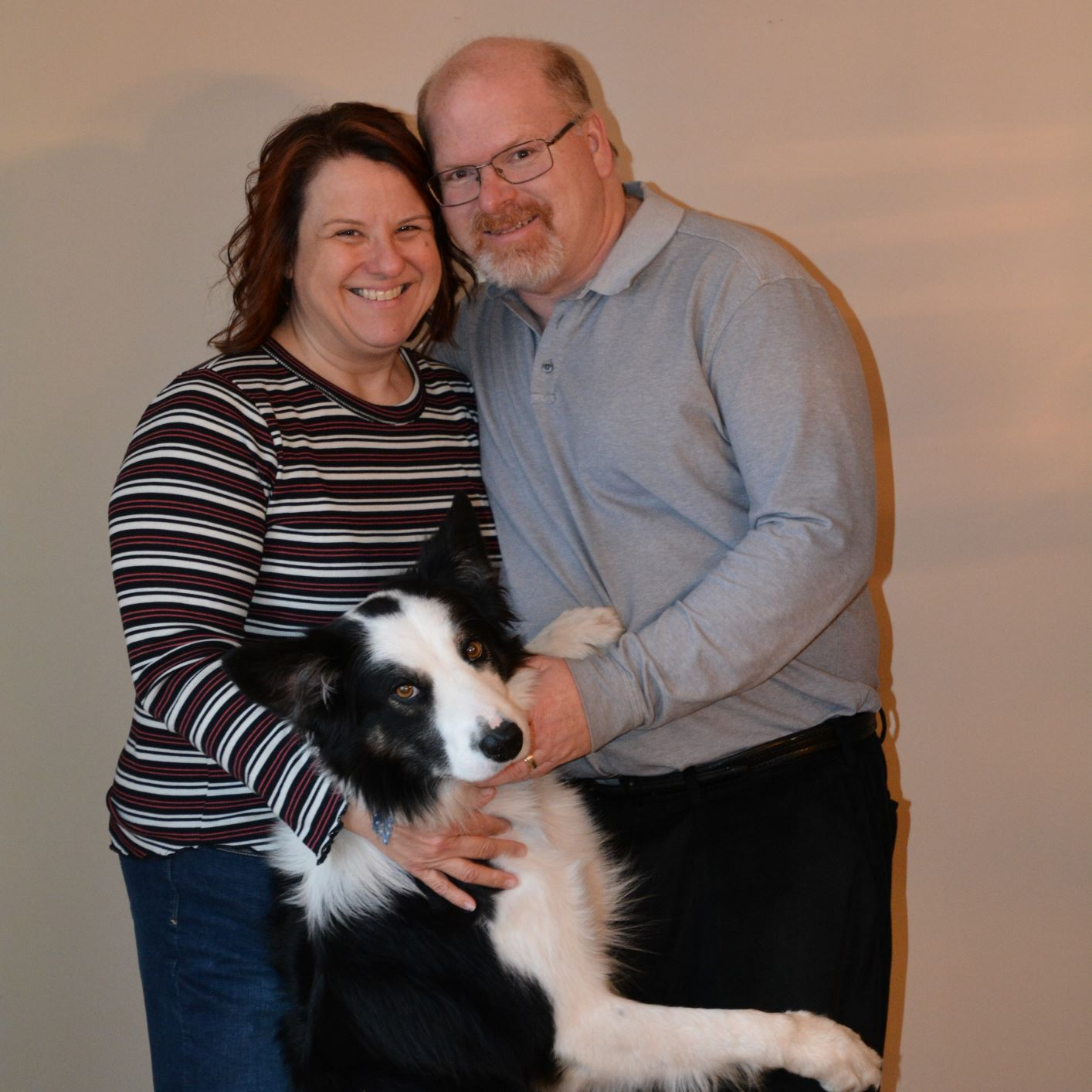 A photo of Donna Lake, her dog and her husband.