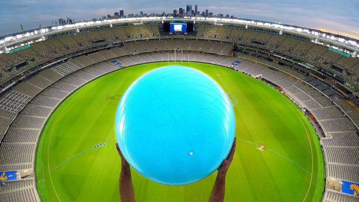 How Ridiculous - CATCHING EXERCISE BALLS with MAGNUS EFFECT from STADIUM ROOF!