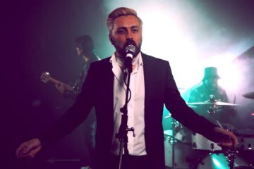 From the Nightclub to the Cross, Just One Touch From The King changed Gospel Rocker Rikki Doolan's life forever