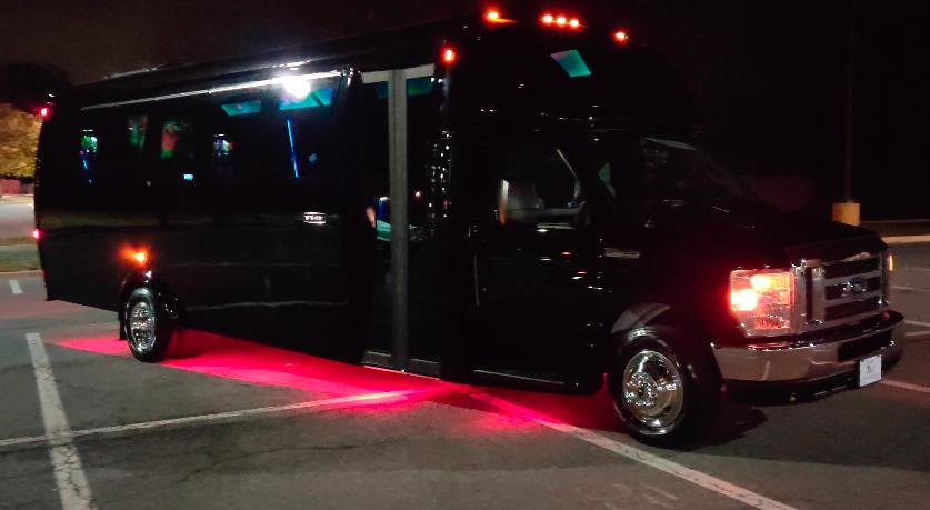 Dicko Transportation 24 Passenger Party Bus under glow