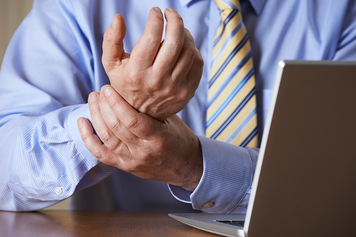 workers compensation, chiropractic, cold laser therapy, work injury, worker's comp, desk job, sitting disease, repeated stress injury, carpal tunnel, workers compensation