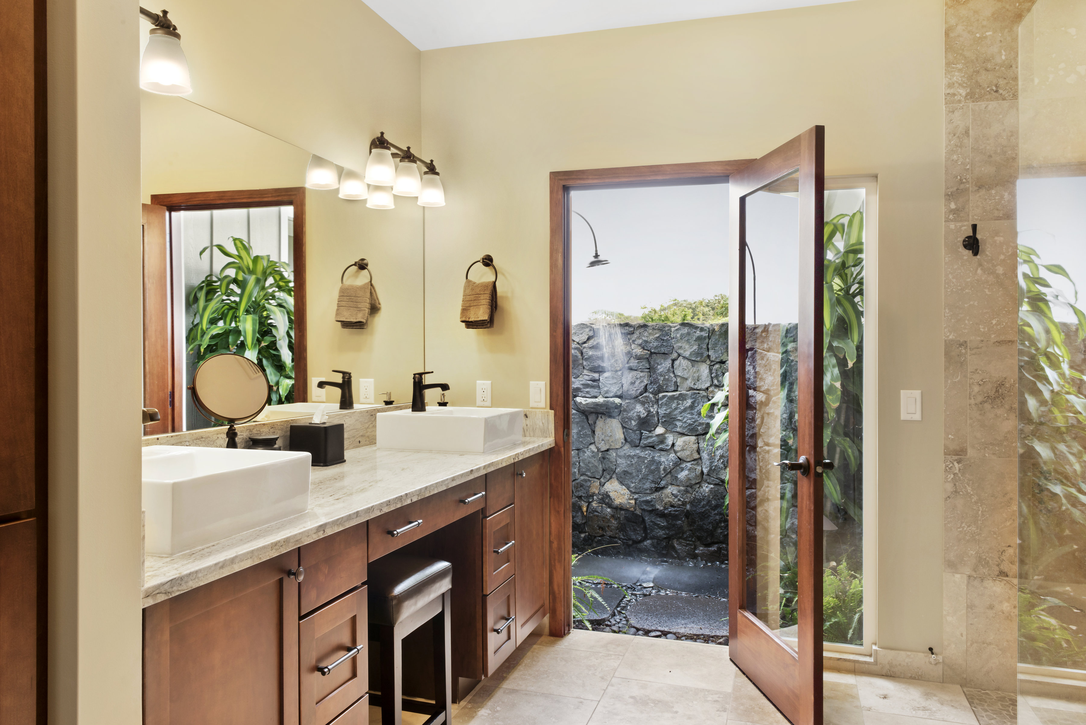 Second master bathroom with outdoor shower.