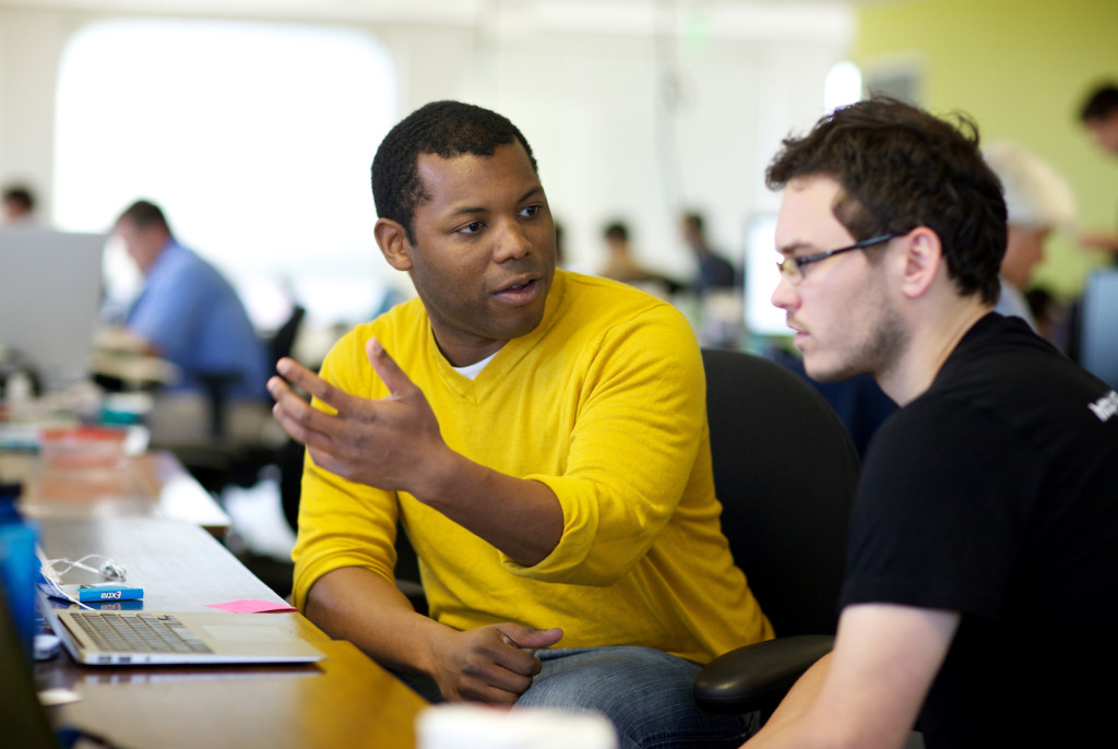 Chris Bennett (center) CEO and co-founder of Central.ly, discusses a business plan with Brett Welch, CEO of Switchcam, at the internet startup incubator space 500 Startups in Mountain View, California, Tuesday, November 15, 2011. Bennett is one of four African-American tech entrepreneurs behind Black Founders, a group that is trying to create opportunities for other African-Americans in the tech industry. Thor Swift For The Bay Citizen