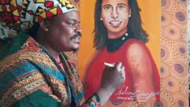 Photo of Leanne Manas Gives Rasta A Word of Encouragement As She Fetches Her Painting