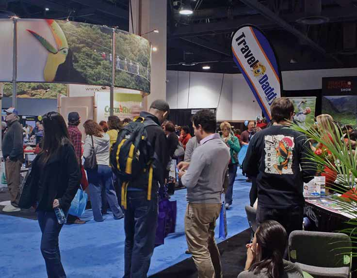 Crowd of people at a consumer trade show travel event