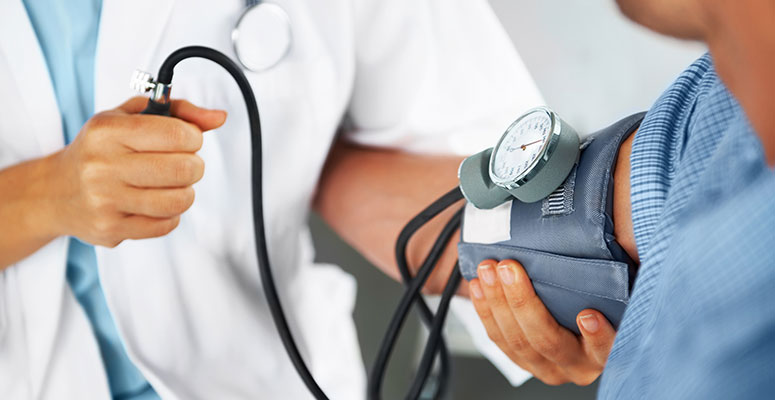 Doctor checking vitals on adult patient