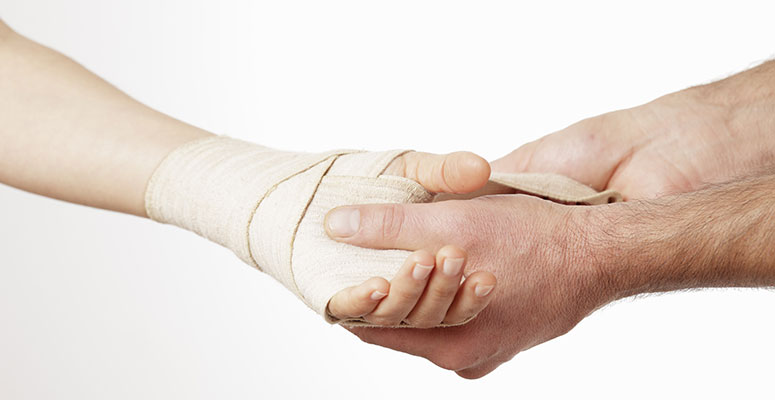 putting a bandage on a hand