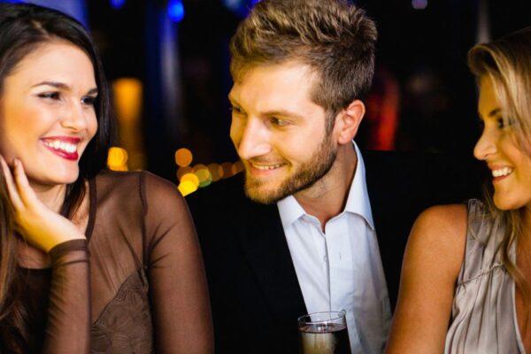 Progress! Guy Hitting On Two Women At Bar Slowly Getting It