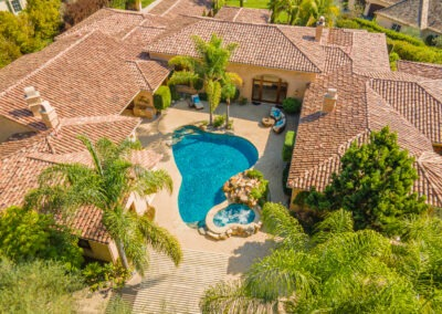 aerial drone shot of courtyard style pool and spa