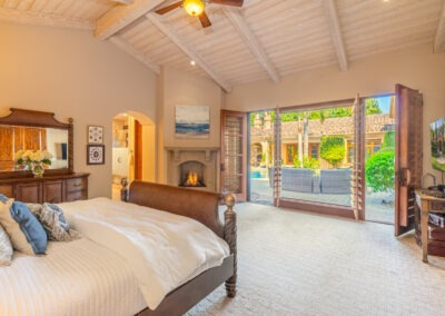 bedroom with fireplace and courtyard view