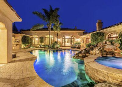 backyard pool and spa at twilight