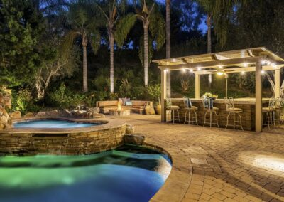 Back yard pool, spa, fire pit and BBQ cabana of custom estate San Diego