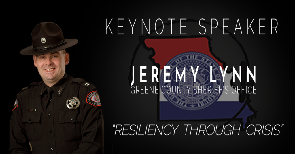 """Black image with a photo of Capt. Lynn in Department Uniform. To the right of Capt. Lynn is the announcement that he is the Keynote Speaker, along with his name below which is Greene County Sheriff's Office. Behind the name and office is a faded version of the MPSCC logo. Below this is the session title """"Resilience Through Crisis"""""""