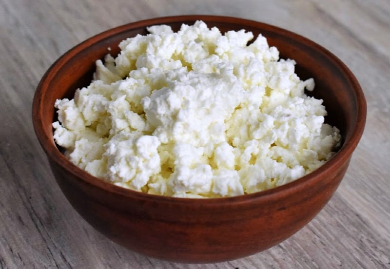 Homemade-Cottage-Cheese-in-Wood-Bowl-on-tabletop