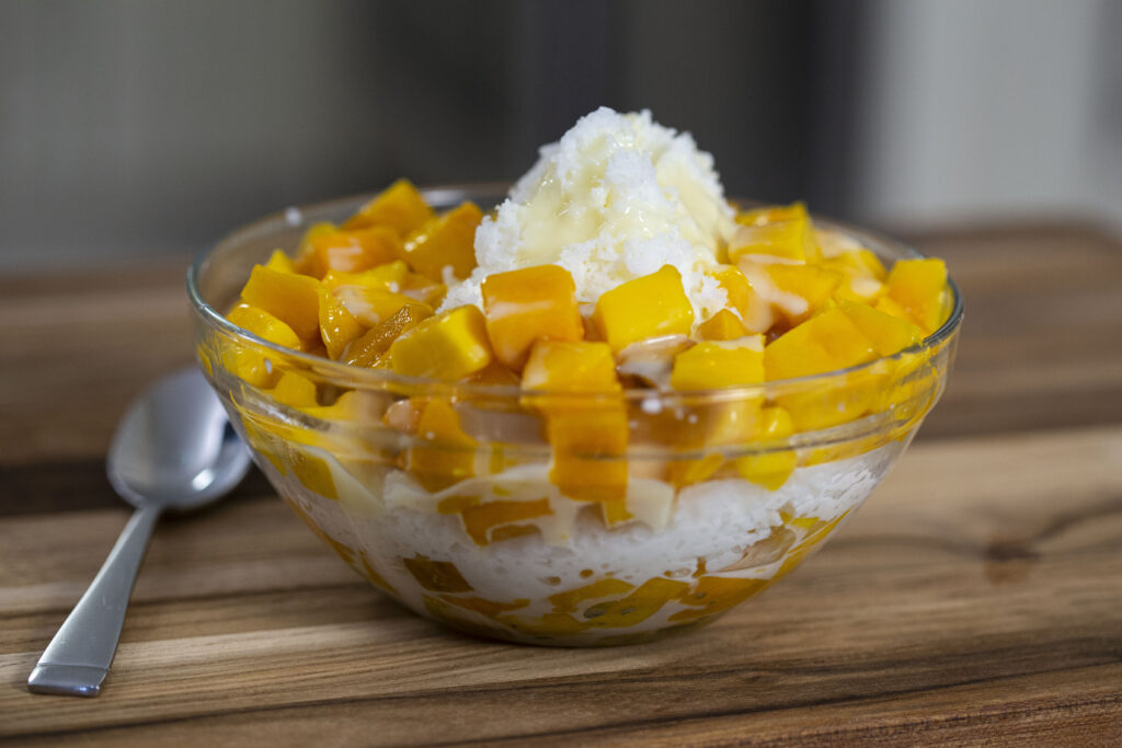 Mango shaved ice with condensed milk drizzled on top. Make at home with no machine.