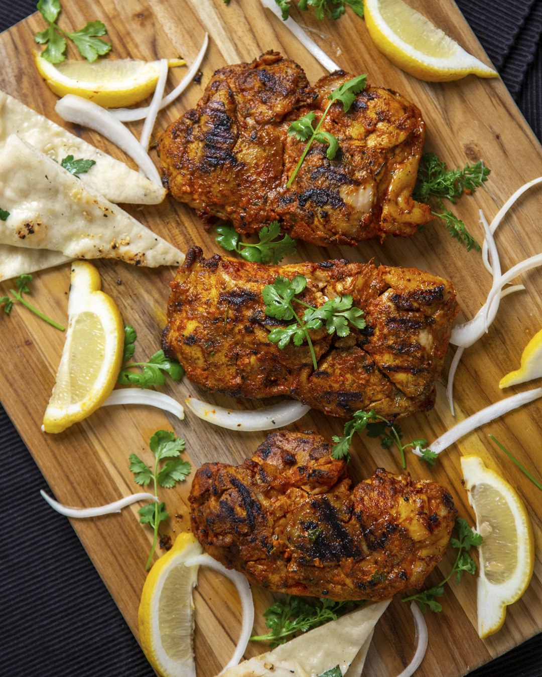 tandoori chicken on chopboard