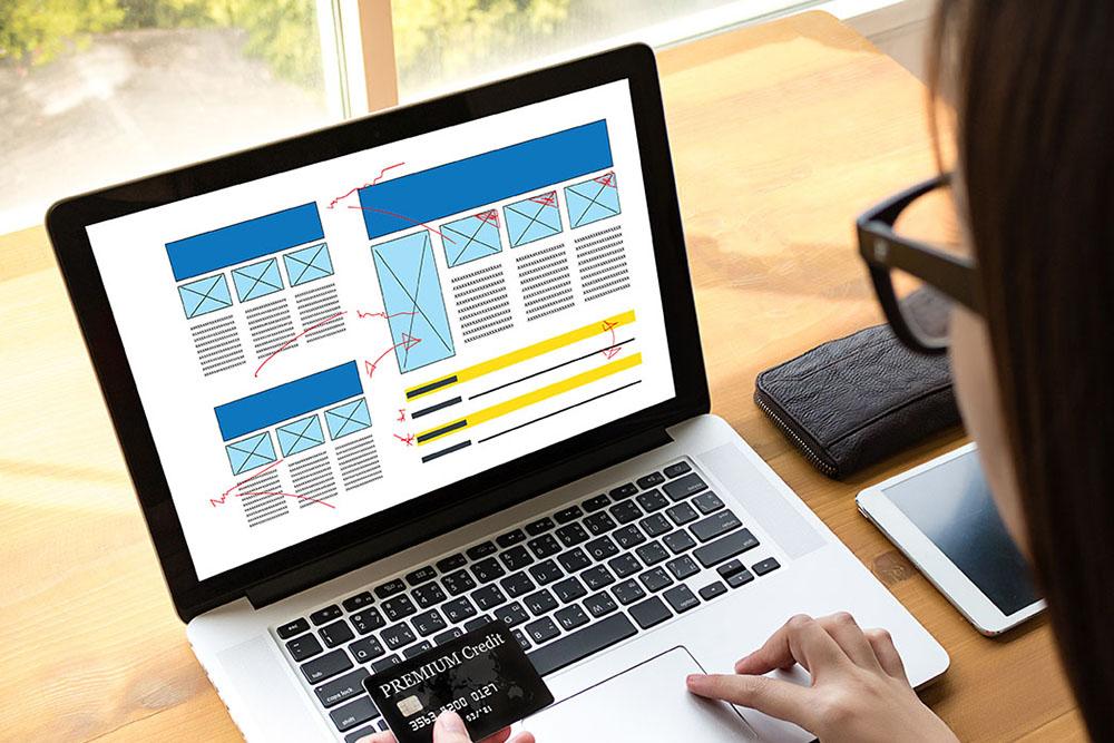 a web designer working on wireframes for design