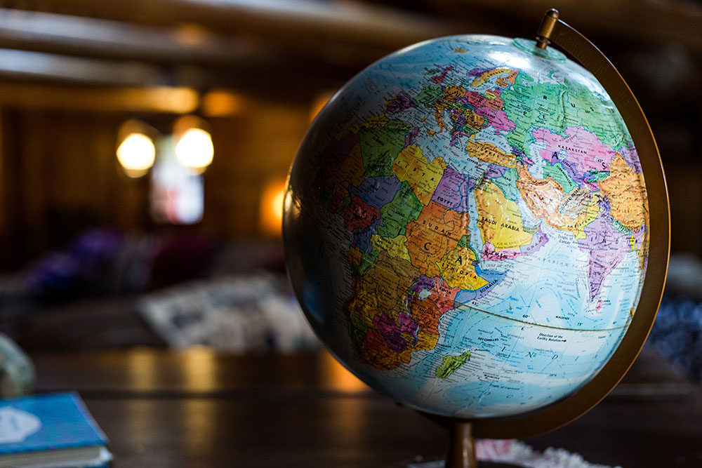 globe on a desk being used in the international audience blog post