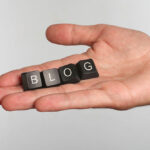 the word blog laid out in dice for the how to write a blog with Wordpress