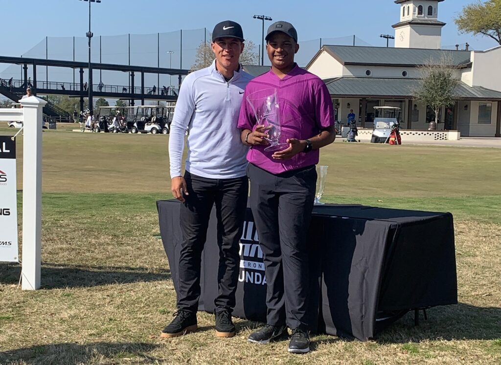 Cameron Champ with Roman Solomon, who won the boys 15- to 18-year-old division.