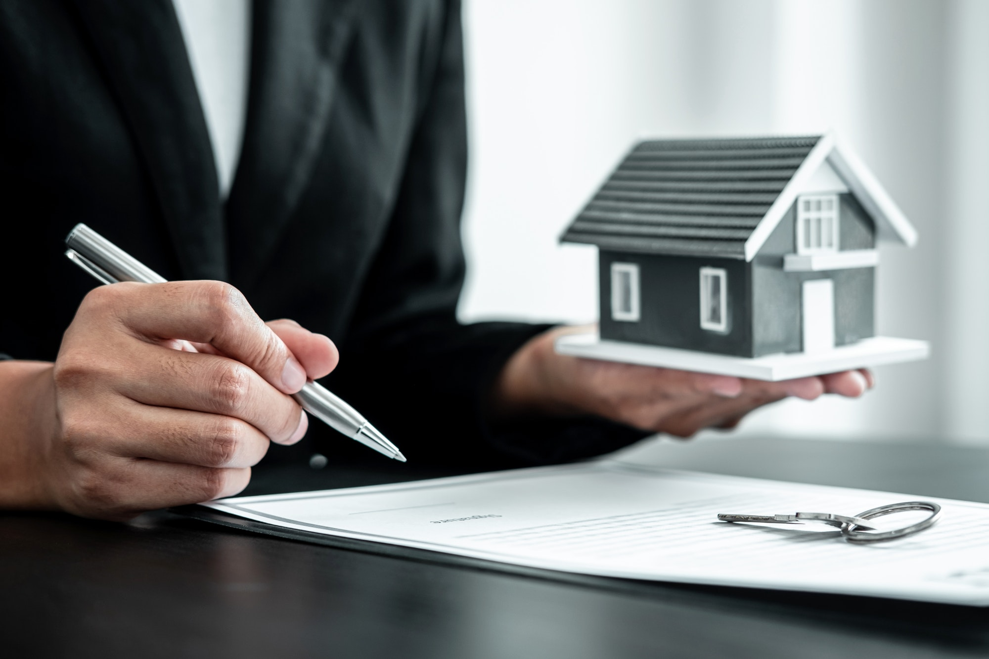 Real estate agent working sign agreement document contract for home loan insurance