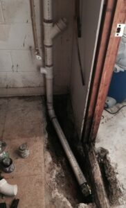 Basement_water_pipes_under_concrete