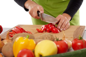 Woman chopping vegetables
