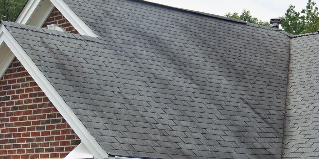 Why are there dark streaks on my roof?