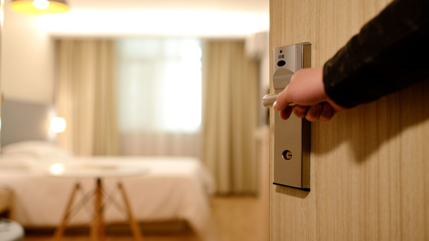 Person walking into a modern hotel room