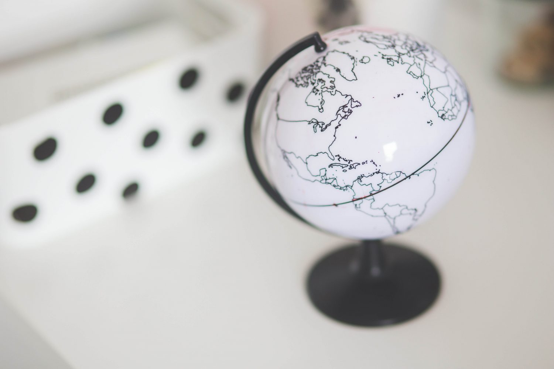 Miniature globe sitting on a desk