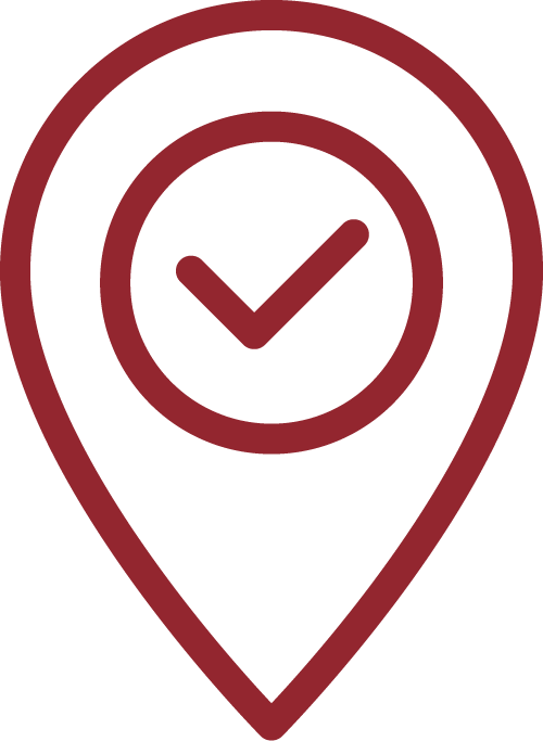 Icon of a location pin with a checkmark inside of it