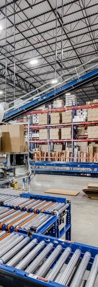 Warehouse interior with conveyer belt system in the foreground