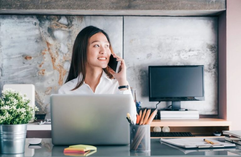 young woman on the phone at a desk