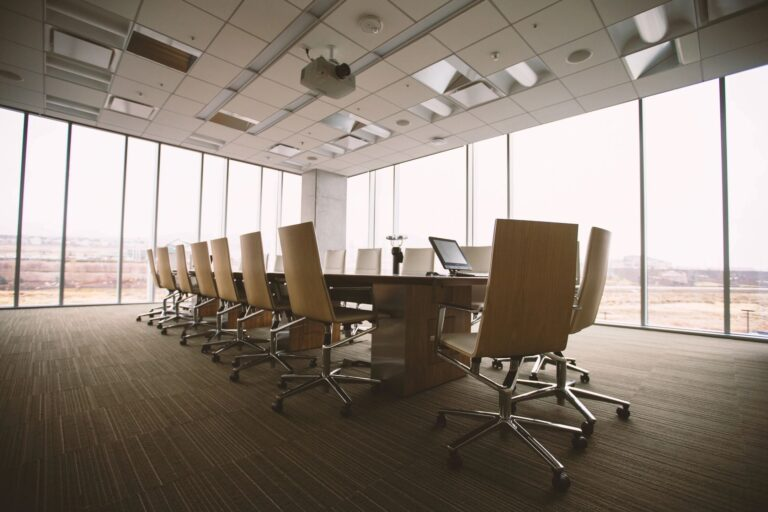 Large conference room table in a modern glass office building