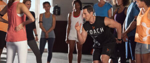 Orange Theory instructor leading a fitness class