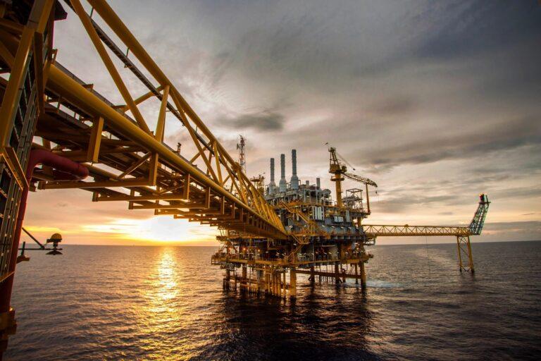 Ocean oil rig at sunset