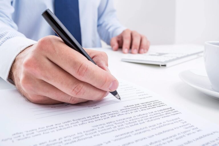Professional worker signing documents