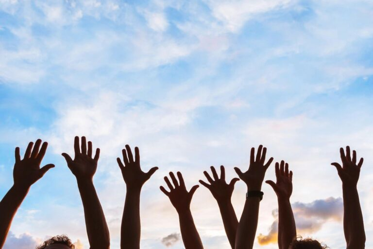 hands raised to the sky in celebration