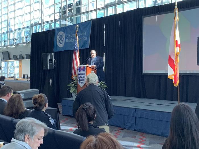 Roberto Munoz at Podium of a Miami World Trade Month Event
