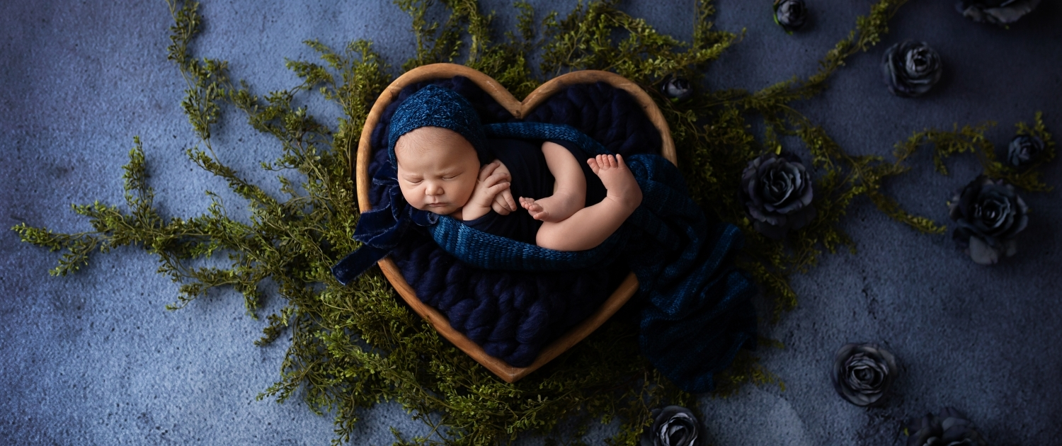 Newborn Portrait with heart shaped basket