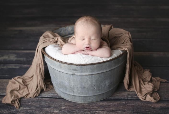 Sleeping baby in bucket