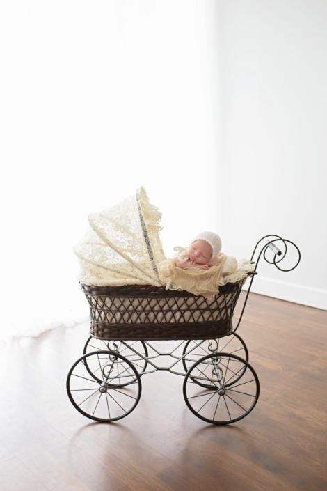 Newborn Photos baby in vintage stroler